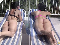 Spanish lesbians Sara May and Pamela Sanchez fuck on a roof