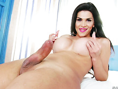 Beautiful tranny Raphaella Ferrari strokes her huge shemale cock