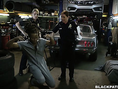 Two white police whores ride a big black cock in a chop shop