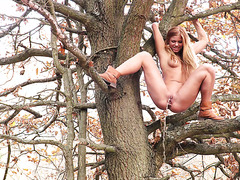 Chrissy Fox plays with her lovely pussy and pisses sitting on a tree