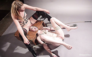 Mistress Mona Wales sits on Riley Nixon's face fucks her with a strapon