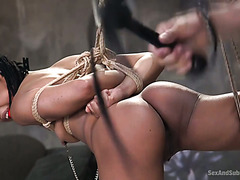 Tied up and suspended ebony sub Kira Noir gets handled by white master