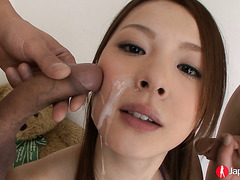 Attractive Asian sweetheart Hitomi Usami sucks two small dicks to get a protein mask