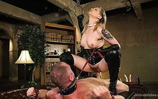 Brutal mistress Maitresse Madeline Marlowe rides her slave boy on the leash