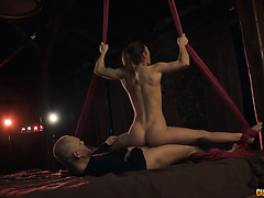 Contortionist Julia Roca rotates on a huge dick in fly yoga swing