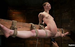 Sensi Pearl is punished by Rain DeGrey in leg split bondage