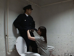 Cute Asian inmate gives blowjob to prison guard in toilet