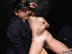 Cop tortures and fucks tanned Asian babe in interrogation room
