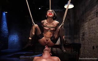 Holly Hendrix enjoys wicked anal punishment in suspended bondage