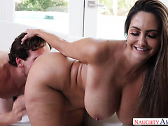 Ava Addams lets young man cover her monster boobs in cum