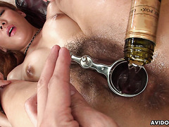 Curvy Japanese beauty is oiled and toyed to wicked squirting