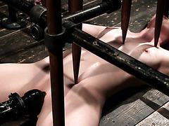 Casey Calvert reaches painful orgasms under wooden spikes