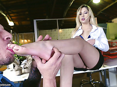 Cute Goldie fucks in an office and licks cum off her toes
