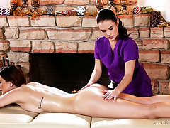 Hot Karlie Montana gets an erotic massage from lovely Megan Rain