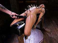 Tied up and gagged Skin Diamond sits on dildo saddle