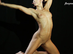 Strong and flexible Eva Rakova does amazing acrobatic tricks
