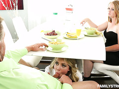 Naughty Cali Sparks sucks her stepdad off sitting under the table