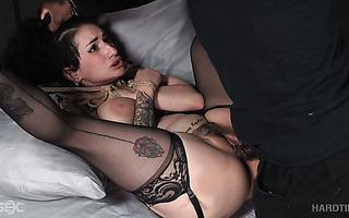 Bondaged Arabelle Raphael gets fucked and toyed by black dude