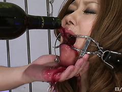 Two dudes makes Jap girl drink lots of wine and suck them off