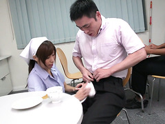 Clumsy Asian nurse Chihiro Akino sucks two guys off in hospital
